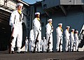 US Navy 060513-N-6410T-011 Honor Guard stands at parade rest aboard the Nimitz-class aircraft carrier USS Theodore Roosevelt (CVN 71) during a burial at sea ceremony.jpg
