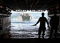 US Navy 060815-N-3557N-049 A Landing Craft Utility (LCU) makes its way into the well deck aboard the amphibious assault ship USS Kearsarge (LHD 3) to offload equipment and supplies.jpg