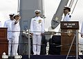 US Navy 070112-N-4400J-049 Commanding Officer Lt. Cmdr. John C. Howard, left, turns over command to the Military Sealift Command (MSC) during a decommissioning ceremony.jpg