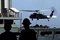 US Navy 070309-N-9928E-093 An HH-60H Seahawk transports pallets between Military Sealift Command (MSC) fast combat support ship USNS Bridge (T-AOE 10) and Nimitz-class aircraft carrier USS John C. Stennis (CVN 74) during a repl.jpg