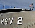 US Navy 070429-N-0989H-001 Quartermaster 2nd Class Dan Bobier aboard High Speed Vessel (HSV) 2 Swift raises the Don't Tread on Me flag.jpg