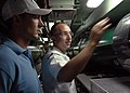 US Navy 070717-N-5268S-002 Electronics Technician 2nd Class John Baumgart shows Jeremy Johnson of the Toledo Mud Hens minor league baseball team the torpedo room aboard attack submarine USS Scranton (SSN 756).jpg