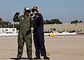 US Navy 070926-N-4007G-004 Actor Lou Diamond Phillips and Aviation Machinist's Mate Airman Misty Dumais signal a helicopter at Helicopter Sea Combat Squadron (HSC) 23 on board Naval Air Station North Island.jpg