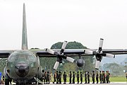 US Navy 080629-N-5961C-001 Servicemen from both the Philippine Air Force and Army unload a C-130 aircraft of food and water for transfer to waiting U.S. helicopters, which will deliver to remote locations throughout Panay Islan