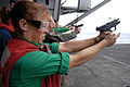 US Navy 080824-N-4005H-367 Aviation Structural Mechanic 3rd Class Erika Mata fires a 9 mm pistol at a target during a small-arms weapons qualifying exercise aboard the Nimitz-class aircraft carrier USS Ronald Reagan (CVN 76).jpg