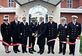 US Navy 081117-N-8848T-831 Members cut a ribbon commemorating the opening of two new barracks at Recruit Training Command.jpg