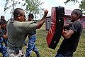 US Navy 090330-N-4143O-003 Cpl. Robert Ortega, a Southern Partnership Station instructor assigned to the Marine Corps Training and Advisory Group, shows a Nicaraguan Marine proper punching technique during a Marine Corps Martia.jpg