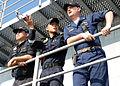US Navy 090611-N-5207L-003 Republic of Singapore Navy Warrant Officers K.C. Tan, left, and Lt. C.H. Chew discuss flight deck operations.jpg