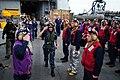 US Navy 100125-N-2953W-169 Rainbow sideboys assigned to amphibious dock landing ship USS Gunstin Hall (LSD 44) render honors to Rear Adm. Ted N. Branch, commander of Carrier Strike Group 1.jpg