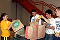 US Navy 100217-N-8020M-042 Mass Communication Specialist 1st Class Jasmin Rodriguez and prospective recruits load bags of food at St. Mary's Food Bank.jpg