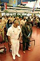 US Navy 100218-N-7498L-132 Chief Religious Programs Specialist Tshombe Harris and guest speaker, Alphonso Braggs, chairperson of the NAACP, bow their heads in prayer during The History of Black Economic Empowerment presentation.jpg