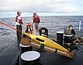 US Navy 100324-N-5060D-003 Danielle Bryant establishes a satellite connection to the Glider Operations Center at NAVOCEANO before launching the seaglider unmanned underwater vessel.jpg