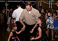 US Navy 100403-N-6674H-003 Aircrew Survival Equipmentman 1st Class Jeremy Simon, assigned to Pearl Harbor Naval Shipyard, dances with his daughters.jpg