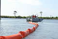 US Navy 100504-N-6268N-027 Members of the Naval Air Station Pensacola Pollution Response unit deploy an oil containment boom at Sherman Cove.jpg