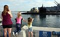 US Navy 101116-N-4047W-004 Family members wave from the pier as the Los Angeles-class attach submarine USS San Francisco (SSN 711).jpg