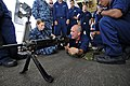 US Navy 110608-N-RC734-139 Fire Controlman 2nd Class Colin Roberts, center, gives familiarization training on the M240 machine gun during a live-fi.jpg