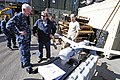 US Navy 110929-N-RC734-079 k Drago, a Scan Eagle technician, center, briefs Rear Adm. Gerard P. Hueber, left, commander of Expeditionary Strike Gro.jpg