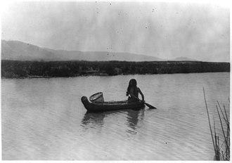 Pomo - A Pomo Indian in a tule boat, circa 1924.