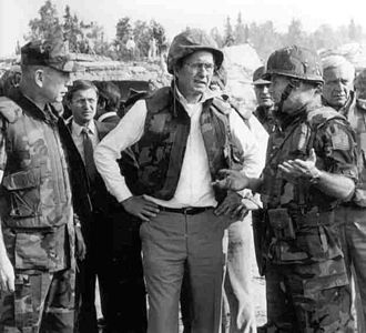 1983 Beirut barracks bombings - Marine Gen. P.X. Kelley (left) and Col. Tim Geraghty (right) take Vice President George H.W. Bush on a tour around the site of the Beirut barracks bombing two days after the explosion.