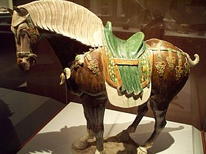 Lead-glazed earthenware - A sancai lead-glazed earthenware saddled horse statuette,  Tang Dynasty (618-907 AD)