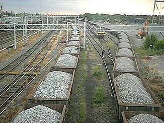 Rail transport operations - Freight wagons await unloading