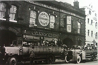 Wakes week - Charabancs picking up passengers in Bury, Lancashire for a wakes week excursion around 1920