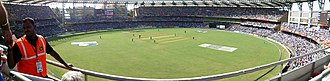 Comparison of baseball and cricket - A panoramic view of Wankhede Stadium, Mumbai, India during the 2011 Cricket World Cup Final.