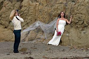 Wedding photography - A modern-day wedding photographer shooting on a beach