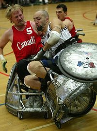 A tackle during a wheelchair rugby game
