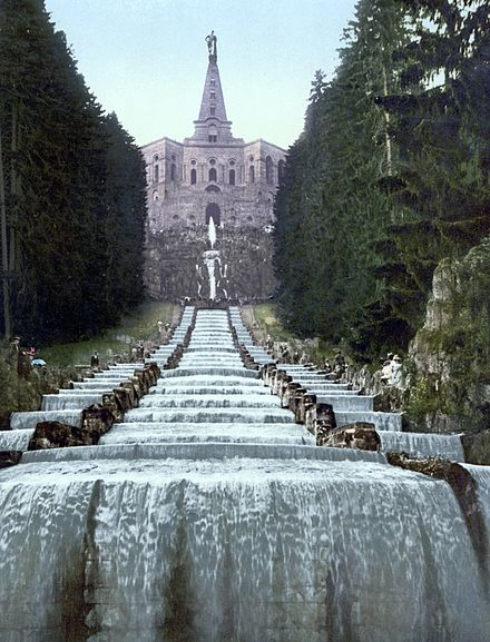 Herkules Monument and water running down the cascades during the water features in the Bergpark of the Wilhelmshöhe Palace Wilhelmshoehe - Herkules mit Kaskaden.jpg