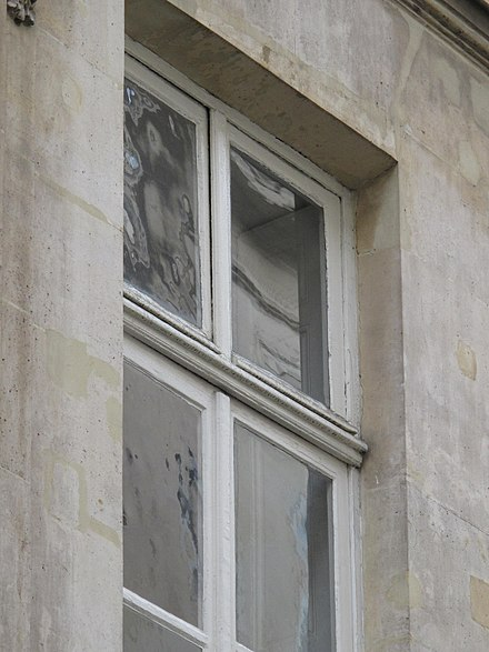 A paned window, showing the contrast between old panes and new, flat panes Window with recent and old panes.jpg