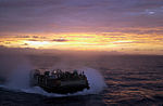 With the sun setting behind them, a Landing Craft Air Cushion (LCAC) from Assault Craft Unit FOUR, Little Creek, Va., prepares to return to USS OAK HILL (LSD 51) in the Arabian Gulf 020414-N-HX866-005.jpg