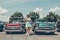 Woman between vintage cars (Unsplash).jpg