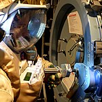 Working on the airlock hatch in the Orlan (8101825627).jpg