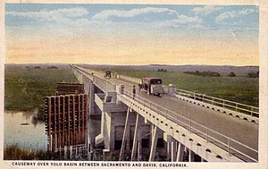 Yolo Causeway - An artist's representation of the original Yolo Causeway. Circa 1920.