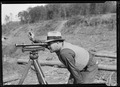 """S. P. Graves, instrument man, working on new construction bridge at Norris Dam."" - NARA - 532685.tif"