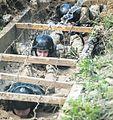 Морські піхотинці долають спеціальну смугу перешкод під час іспиту на право гордо носити чорний берет (27792205915).jpg
