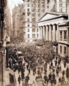 A swarm gathers on Wall Street during the bank panic in October 1907