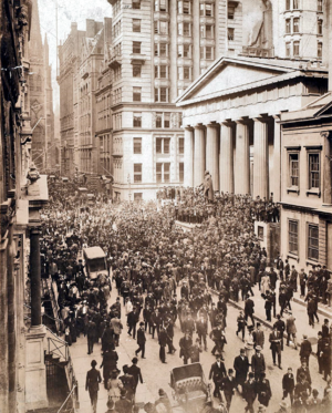 English: A crowd forms on Wall Street during t...