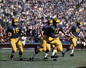 History of Michigan Wolverines football in the Elliott years - Fred Julian carries the ball for Michigan in 1959.