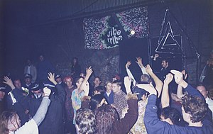 MDMA - A 1995 Vibe Tribe rave in Erskineville, New South Wales, Australia being broken up by police. MDMA use spread globally along with rave culture.
