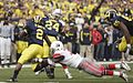20091121 Vincent Smith runs behind Kevin Grady lead block as Brian Rolle attempts a tackle.jpg