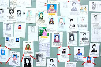 2013 Savar building collapse - Board with photos of missing people posted by relatives
