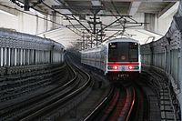 201604 An AC01 train drives under the gonghexin bridge.JPG