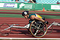211000 - Athletics wheelchair racing 10km heat John Maclean action 3 - 3b - 2000 Sydney race photo.jpg