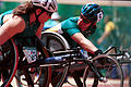 241000 - Athletics wheelchair racing Louise Sauvage Christie Skelton talking - 3b - 2000 Sydney race photo.jpg