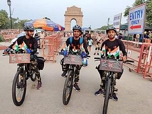 Three men on bicycles