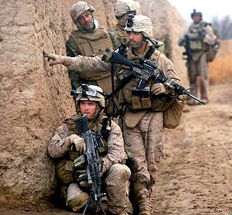 Counter-insurgency - U.S. Marines and ANA soldiers on patrol during counter-insurgency operations in Marjah, Afghanistan, February 2010