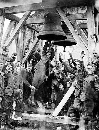 80th Division (United States) - Private J. R. Fletcher, 80th Division, and children of Vaubecourt ring church bells that had been blown from the belfry by Germans forces in 1914 on their retreat from the town (October 21, 1918)