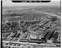 AERIAL VIEW LOOKING SOUTHWEST, SHOWING GROWTH OF ARSENAL OUTWARD FROM FROM ORIGINAL SITE (CENTER RIGHT). - Frankford Arsenal, South of Tacony Street between Bridge Street and HAER PA,51-PHILA,693-6.tif
